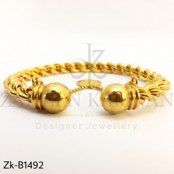 Twisted coin bangle