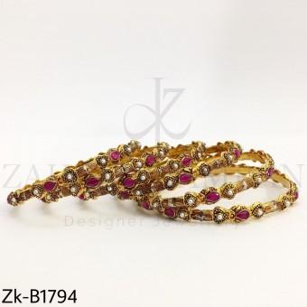 Ruby pearls bangles