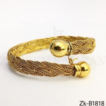 Golden braided bangle