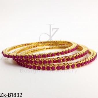 Ruby gold bangles
