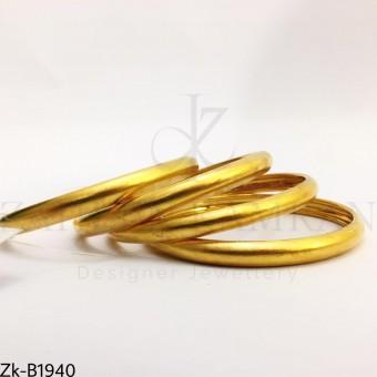 Broad golden bangles