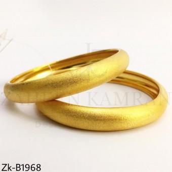 Broad glittery bangles