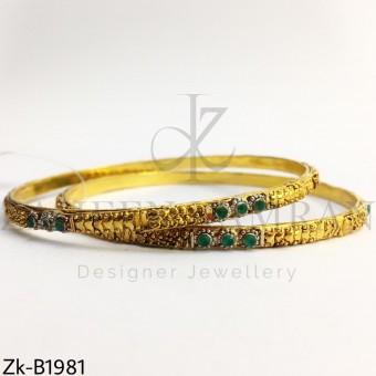 Sleek emerald bangles