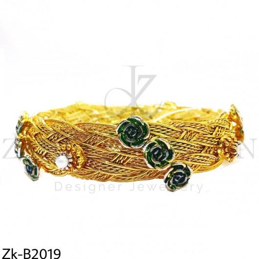 Broad braided bangle