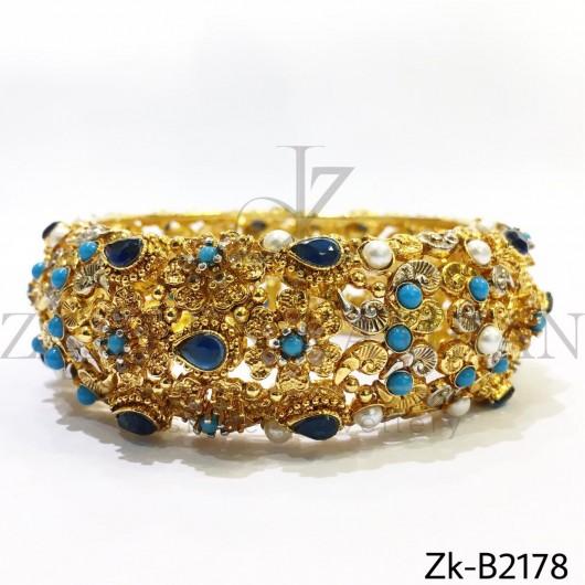 Broad detailed bangle
