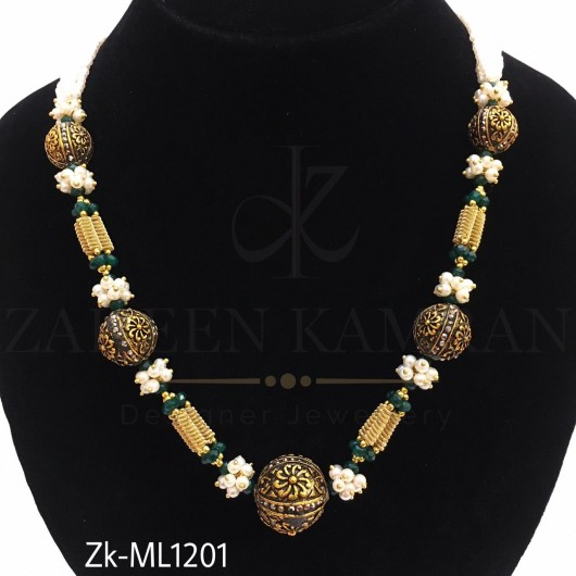 Emerald pearl string