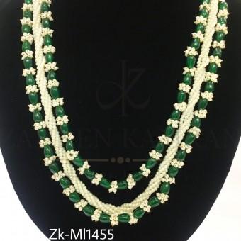 Handwoven emerald mala